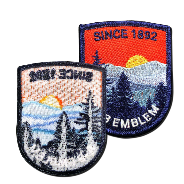 Image showing the back of embroidered patch. A-B Emblem. Since 1892. Iron-on backing shown.