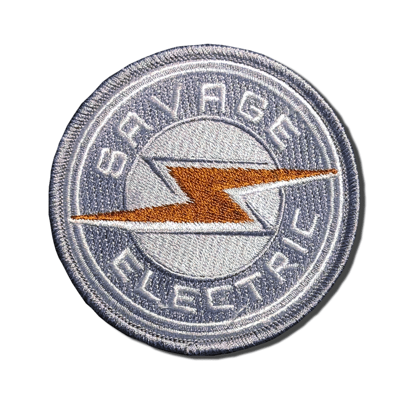 Savage Electric Round Patch. A-B Emblem Photo Gallery Image.