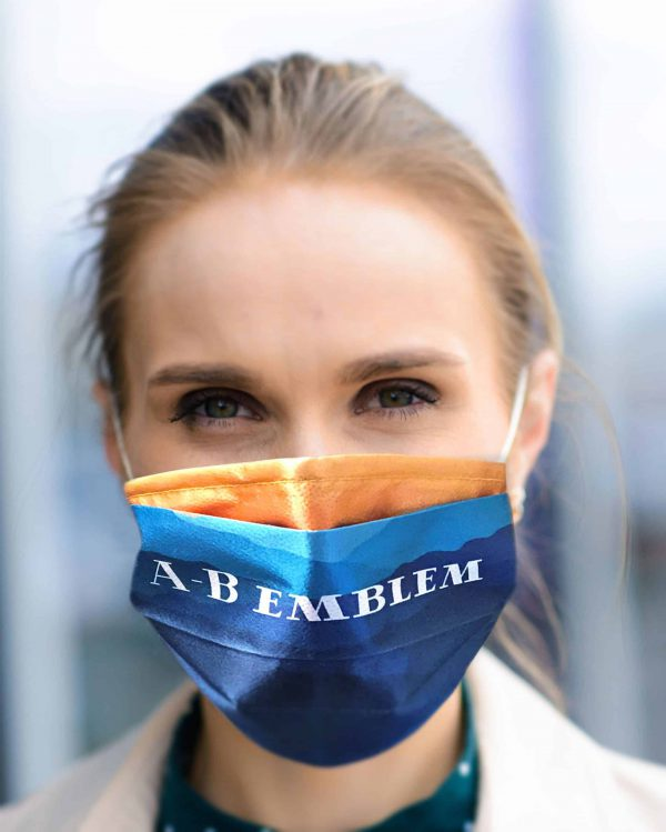 A-B Emblem Custom Printed Face Mask example being worn by an adult woman.